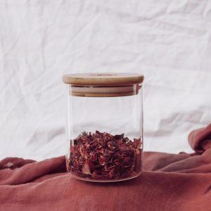 Glass tea canister with rose tea